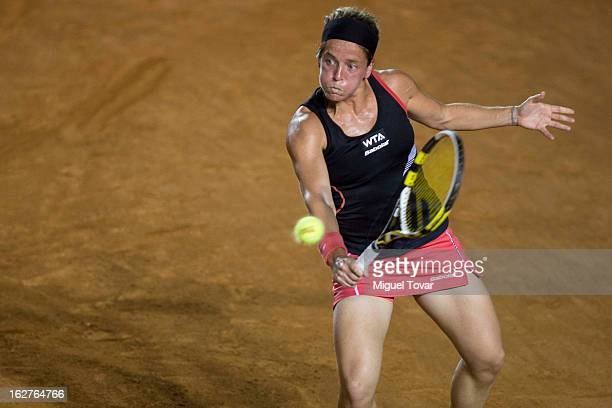 Lourdes Dominguez from Spain in action during a match against Italy«s Flavia Pennetta during a match as part of the Mexican Tennis Open Acapulco 2013...