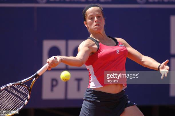 Lourdes Dominguez Lino in action against Kaia Kanepi during their second round match in the 2006 Estoril Open in Estoril, Portugal on May 4, 2006.