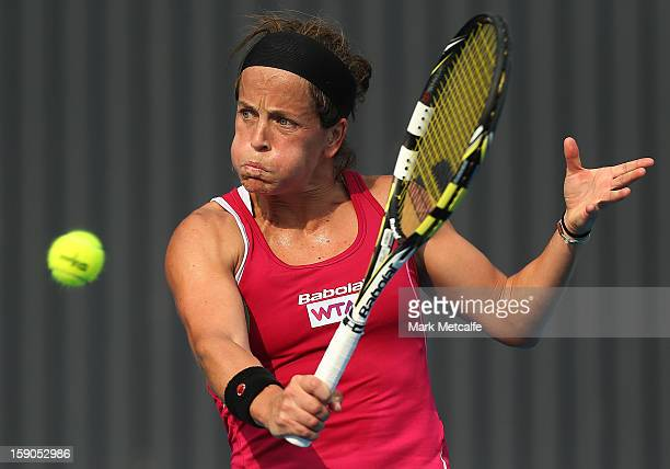 Lourdes Dominguez Lino of Spain plays a backhand in her first round match against Yaroslava Shvedova of Kazakhstan during day four of the Hobart...