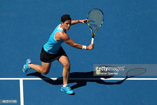 Lourdes Dominguez Lino of Spain plays a backhand in her first round match against Caroline Wozniacki of Denmark during day two of the 2014 Australian...