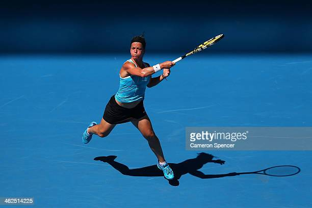 Lourdes Dominguez Lino of Spain plays a forehand in her first round match against Caroline Wozniacki of Denmark during day two of the 2014 Australian...