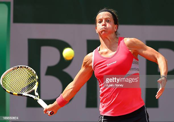 Lourdes Dominguez Lino of Spain plays a forehand in her Women's Singles match against Bethanie Mattek-Sands of United States of America during day...