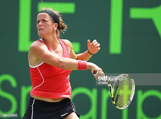 Lourdes Dominguez Lino of Spain returns a shot against Svetlana Kuznetsova of Russia Lourdes Dominguez Lino of Spain during Day 3 of the Sony Open at...