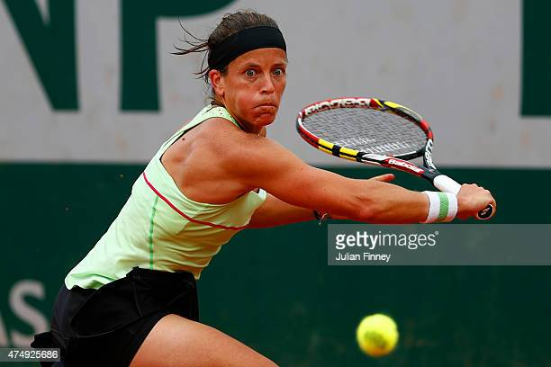 Lourdes Dominguez Lino of Spain returns a shot during her women's singles match against Andrea Petkovic of Germany on day five of the 2015 French...