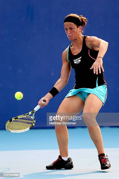 Lourdes Dominguez Lino of Spain returns a shot to Laura Robson of Great Britain during the China Open at the China National Tennis Center on October...