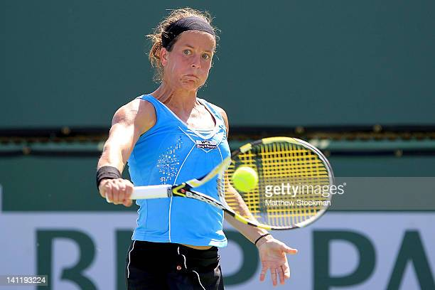 Lourdes Dominguez Lino of Spain returns a shot to Maria Kirilenko of Russia during the BNP Paribas Open at the Indian Wells Tennis Garden on March...