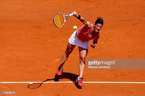 Lourdes Dominguez Lino of Spain serves during the women's singles round one match between Vera Zvonareva of Russia and Lourdes Dominguez Lino of...