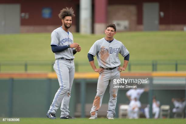 Lourdes Gurriel and Luis Urias of Peoria Javelinas react on the field in the Arizona Fall League game against the Mesa Solar Sox at Sloan Park on...