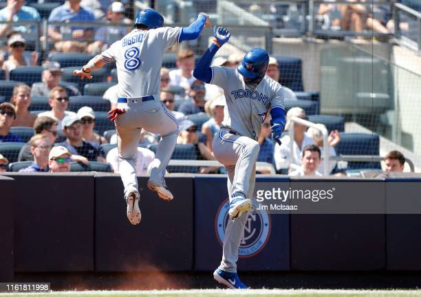 Lourdes Gurriel Jr. #13 and Cavan Biggio of the Toronto Blue Jays celebrate after both scored during the sixth inning against the New York Yankees at...