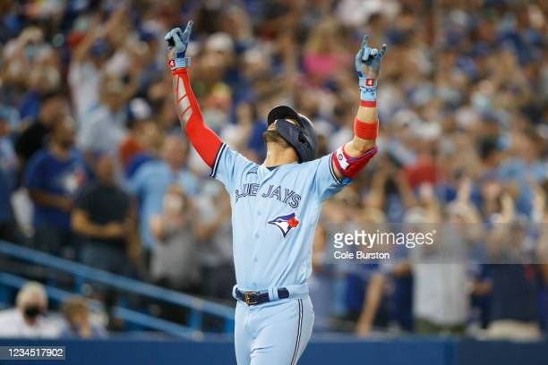 Lourdes Gurriel Jr. #13 of the Toronto Blue Jays celebrates a home run at the plate in the fifth inning of their MLB game against the Boston Red Sox...