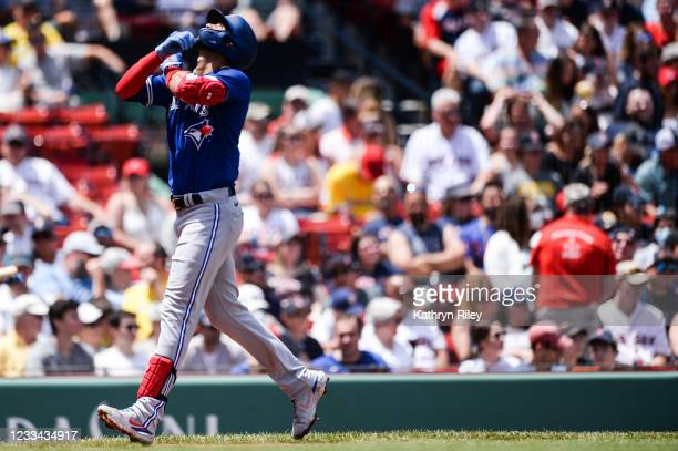Lourdes Gurriel Jr. #13 of the Toronto Blue Jays celebrates after hitting a solo home run in the first inning against the Boston Red Sox at Fenway...