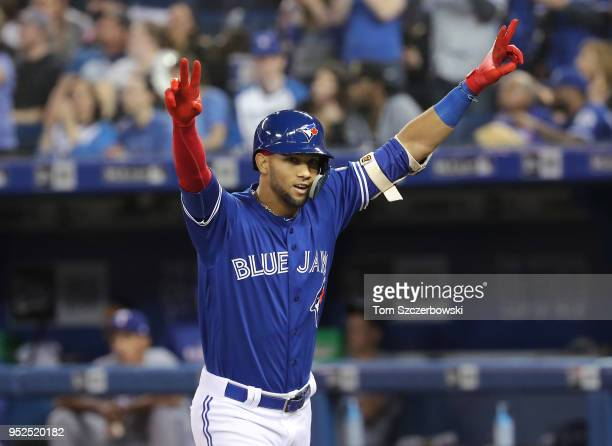 Lourdes Gurriel Jr #13 of the Toronto Blue Jays celebrates after hitting his first career MLB home run a solo shot in the seventh inning during MLB...