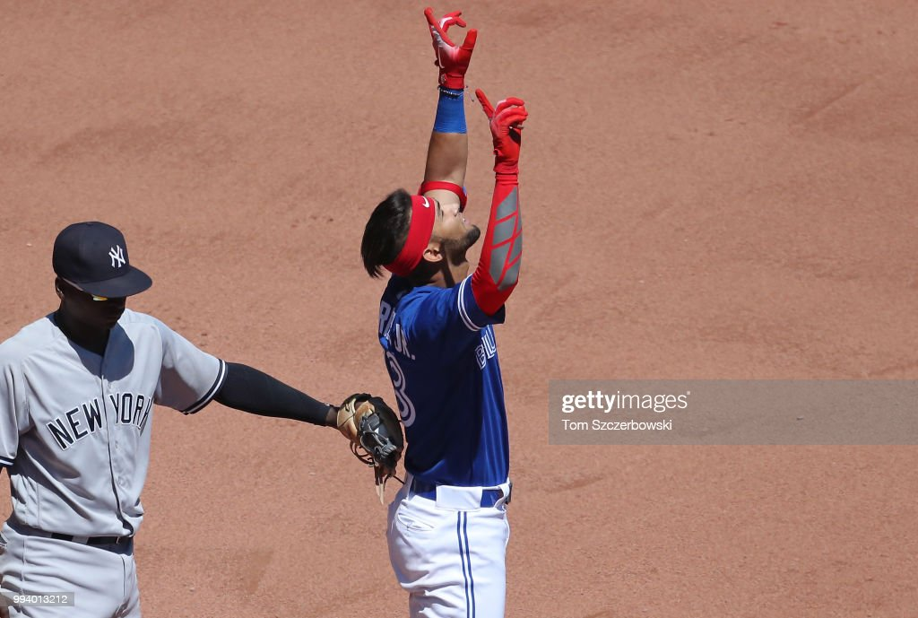 Lourdes Gurriel Jr. #13 of the Toronto Blue Jays celebrates at second base after hitting a double in the seventh inning during MLB game action against the New York Yankees at Rogers Centre on July 8, 2018 in Toronto, Canada.