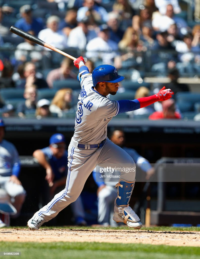 Lourdes Gurriel Jr. #13 of the Toronto Blue Jays follows through on a fifth inning single against the New York Yankees at Yankee Stadium on April 21, 2018 in the Bronx borough of New York City.