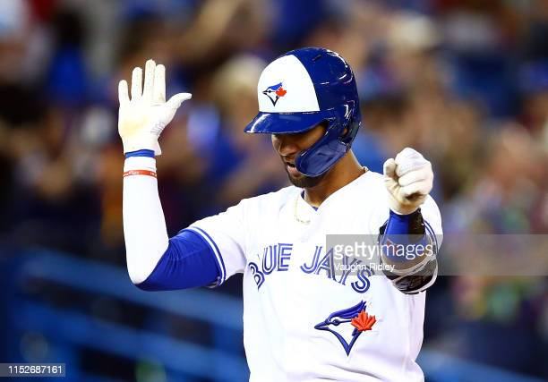 Lourdes Gurriel Jr #13 of the Toronto Blue Jays hits a home run in the eighth inning during a MLB game against the Kansas City Royals at Rogers...