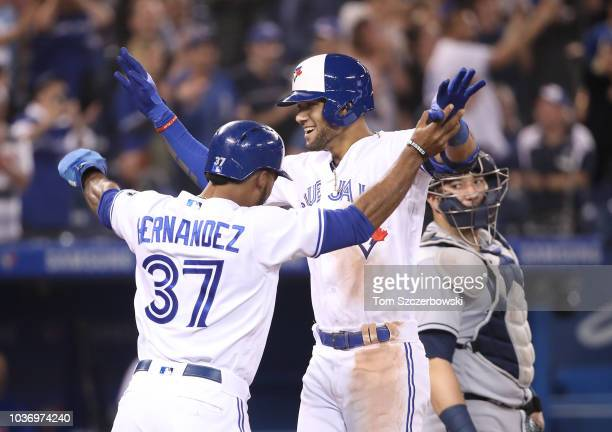 Lourdes Gurriel Jr #13 of the Toronto Blue Jays is congratulated by Teoscar Hernandez after hitting a tworun home run in the ninth inning during MLB...