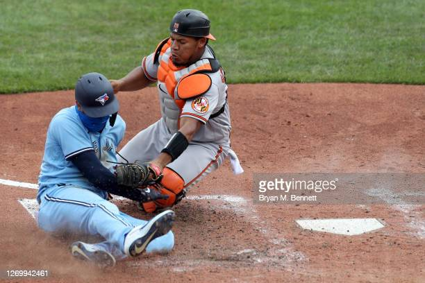 Lourdes Gurriel Jr. #13 of the Toronto Blue Jays is tagged out by Pedro Severino of the Baltimore Orioles on a fielders choice by Hanser Alberto of...
