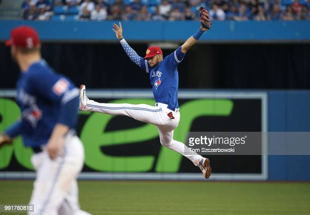 Lourdes Gurriel Jr #13 of the Toronto Blue Jays makes a leaping catch off a liner in the fifth inning during MLB game action against the New York...