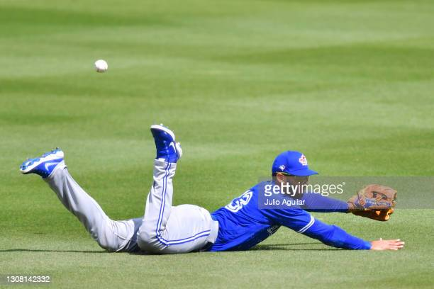 Lourdes Gurriel Jr. #13 of the Toronto Blue Jays misses a ball hit by Jeff Mathis of the Philadelphia Phillies in the fifth inning during a spring...