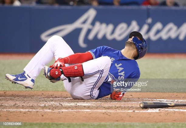 Lourdes Gurriel Jr #13 of the Toronto Blue Jays reacts after being hit by pitch in the tenth inning during MLB game action against the Cleveland...