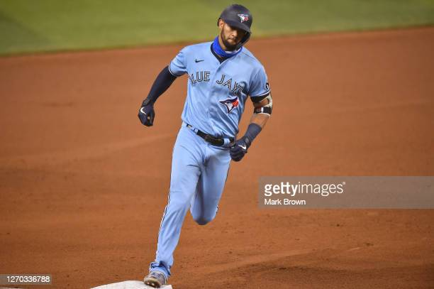 Lourdes Gurriel Jr. #13 of the Toronto Blue Jays runs the bases after hitting two-run home run in the fifth inning against the Miami Marlins at...