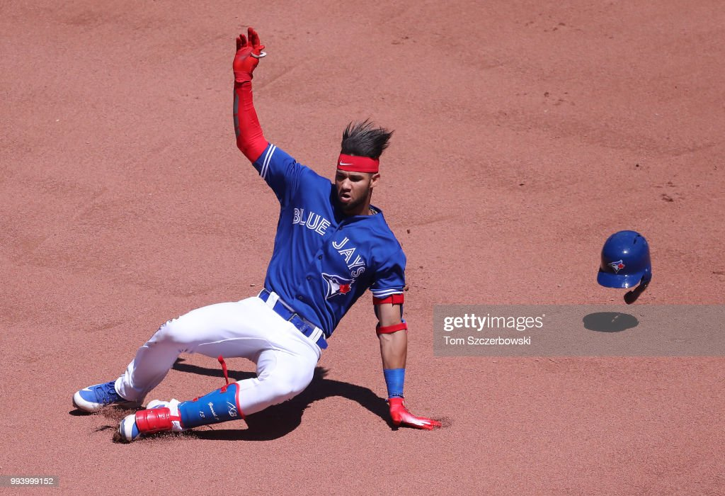 Lourdes Gurriel Jr. #13 of the Toronto Blue Jays slides into second base as he hits a double in the seventh inning during MLB game action against the New York Yankees at Rogers Centre on July 8, 2018 in Toronto, Canada.