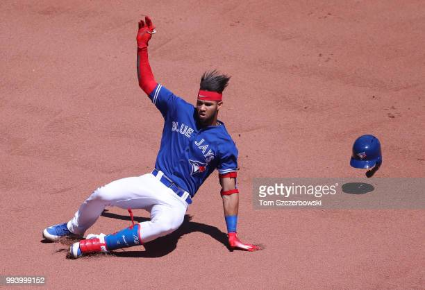 Lourdes Gurriel Jr #13 of the Toronto Blue Jays slides into second base as he hits a double in the seventh inning during MLB game action against the...