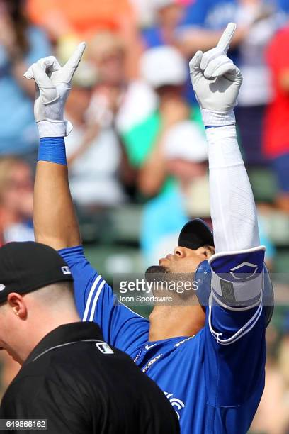 Lourdes Gurriel of the Blue Jays completes his home run trot by looking up to the skies wrapping his arms around himself and points skyward during...