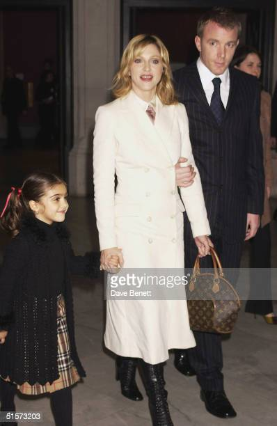 Lourdes Madonna and Guy Ritchie attend the Mario Testino Exhibition at The National Portrait Gallery on January 30 2002 in London