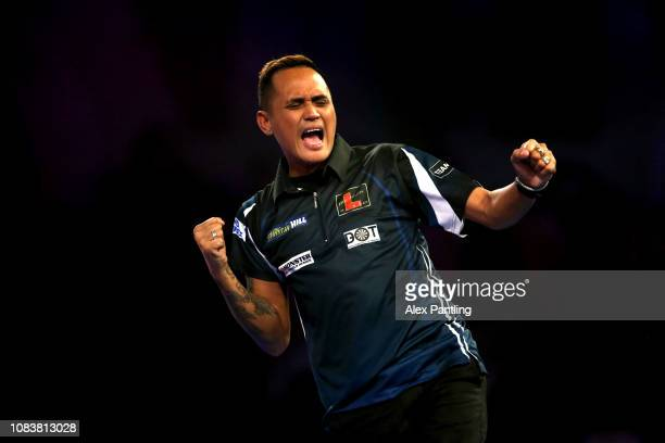 Lourence Ilagan of the Philippines celebrates during his first round match Vincent van der Voort of the Netherlands against during Day five of the...