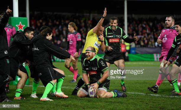 Lourens Adriaanse of Paloise celebrates with team mates after scoring during the European Rugby Challenge Cup match between Gloucester and Section...