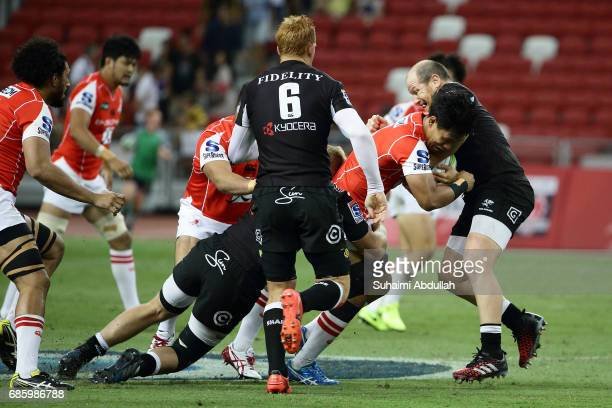 Lourens Adriaanse of Sharks tackles Yoshitaka Tokunaga of Sunwolves during the round 13 Super Rugby match between the Sunwolves and the Sharks at...
