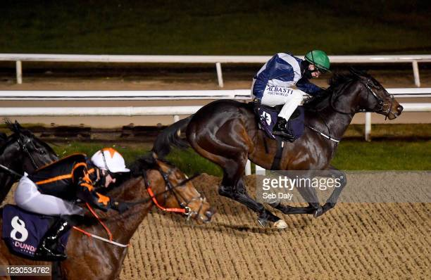Louth , Ireland - 11 January 2021; The Highway Rat, right, with Gary Carroll up, leads the field on their way to winning the Follow Us On Twitter...
