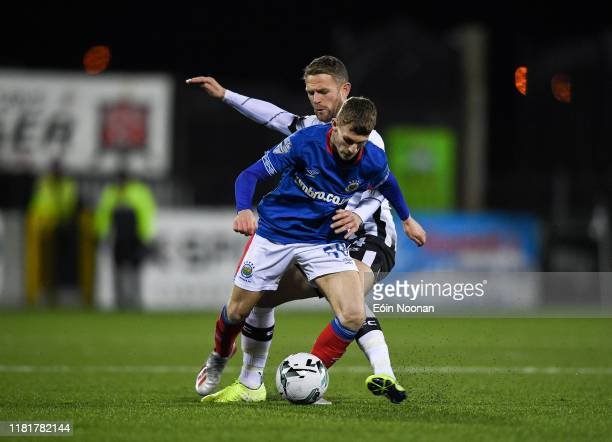 Louth , Ireland - 11 November 2019; Charlie Allen of Linfield in action against Dane Massey of Dundalk during the Unite the Union Champions Cup...