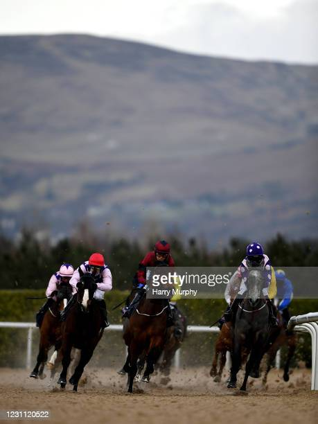 Louth , Ireland - 12 February 2021; Niamh Elizabeth, right, with Sorcha Woods up, leads the field during the Follow Us On Twitter @DundalkStadium...