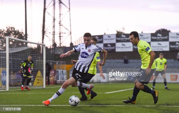 Louth , Ireland - 16 August 2019; Daniel Kelly of Dundalk in action against Jacob Borg of Finn Harps during the SSE Airtricity League Premier...