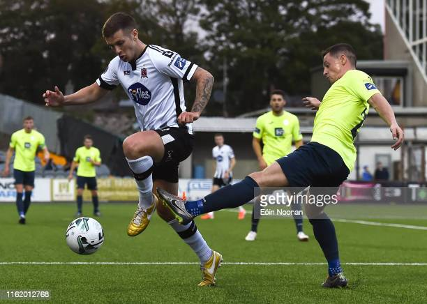 Louth , Ireland - 16 August 2019; Patrick McEleney of Dundalk is tackled by Ruairí Harkin of Finn Harps during the SSE Airtricity League Premier...