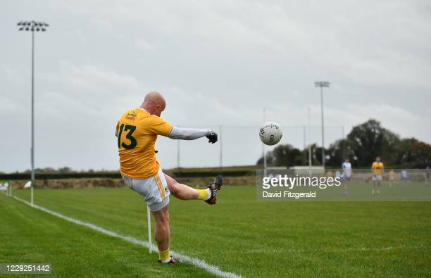Louth , Ireland - 24 October 2020; Patrick Cunningham of Antrim kicks a point from a sideline free during the Allianz Football League Division 4...