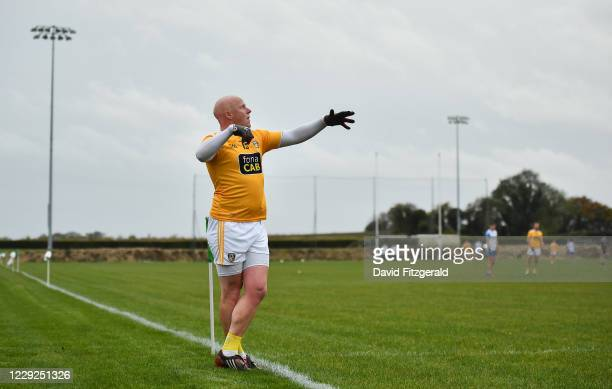 Louth , Ireland - 24 October 2020; Patrick Cunningham of Antrim watches his sideline free go over the bar during the Allianz Football League Division...