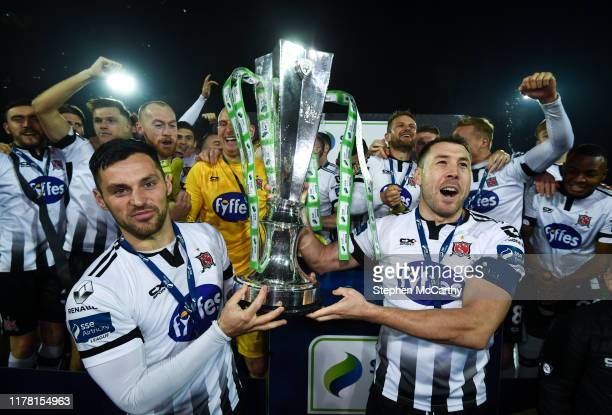 Louth , Ireland - 25 October 2019; Dundalk Brian Gartland, right, and Patrick Hoban celebrate with the SSE Airtricity League Premier Division trophy...