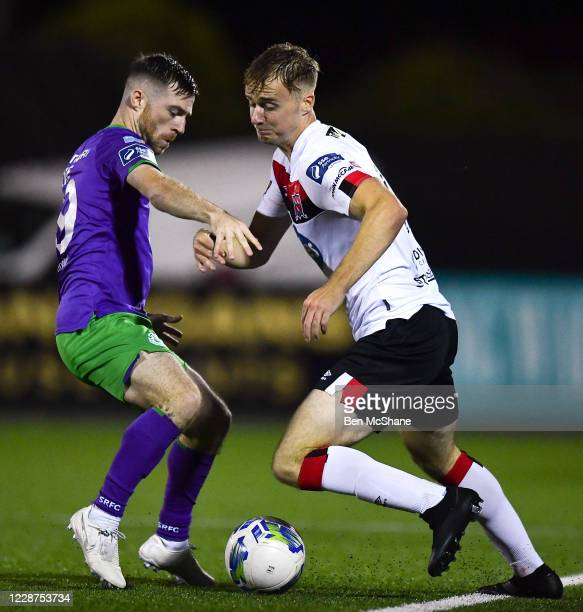 Louth , Ireland - 27 September 2020; Andrew Quinn of Dundalk in action against Jack Byrne of Shamrock Rovers during the SSE Airtricity League Premier...