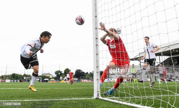 Louth , Ireland - 8 July 2021; Han Jeongwoo of Dundalk heads his side's fourth goal during the UEFA Europa Conference League first qualifying round...