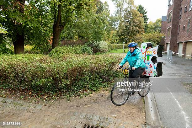 LouvainlaNeuve Belgium October 16 2014 The 24h vélo de LouvainlaNeuve is a student folklorique race in the student city of LouvainlaNeuve