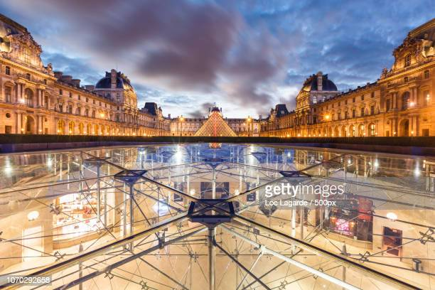 louvre by night - lagarde stock photos and pictures
