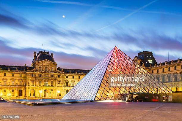 Louvre museum and pyramid at dawn, Paris, France