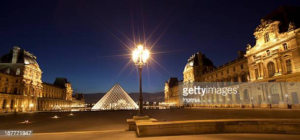 louvre museum at dusk - louvre pyramid stock pictures, royalty-free photos & images