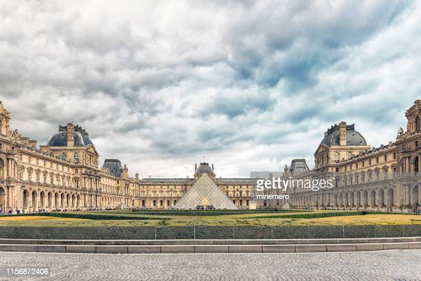 louvre museum - louvre pyramid stock pictures, royalty-free photos & images