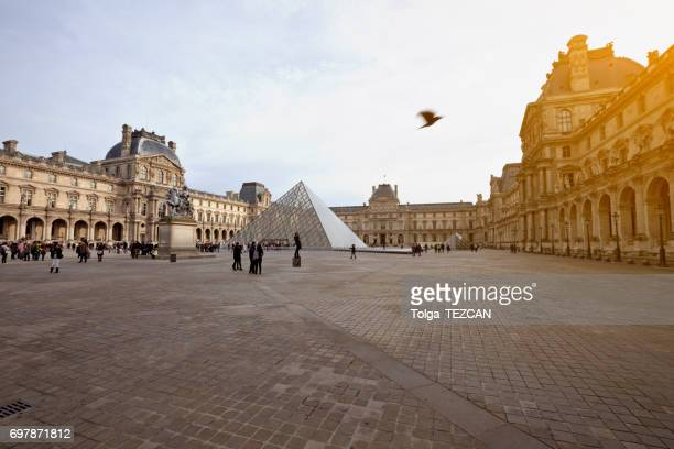 louvre museum - louvre pyramid stock photos and pictures