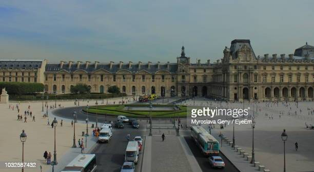louvre palace against sky in city - チュイルリー地区 ストックフォトと画像