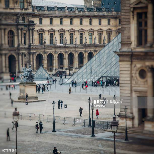 louvre palace and the pyramid - louvre pyramid stock photos and pictures